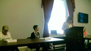 Carmela DeCandia presents data on homeless women and trauma, demonstrating that 93% of mothers had a history of trauma leading many to be diagnosed with PTSD. (PHOTO: NLIHC)
